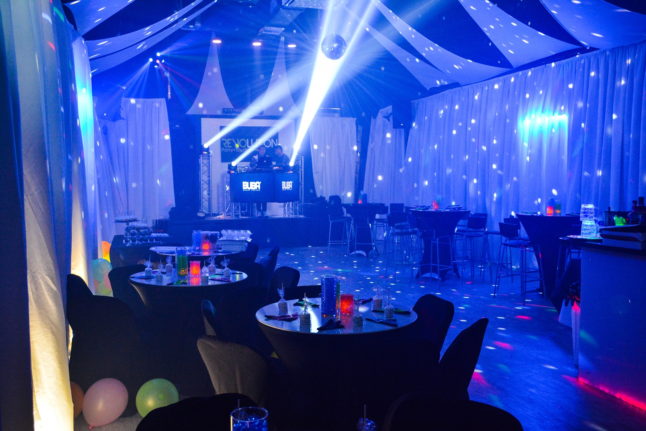 Light show with blue lights in an event venue