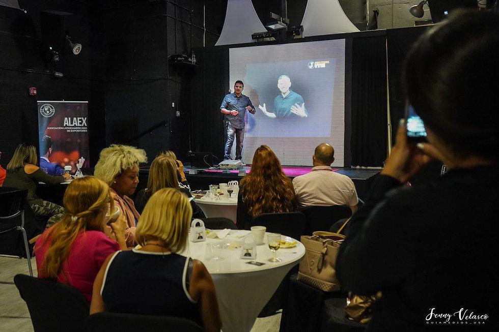 Man giving speech in event venue in Miami
