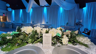 table with roses in banquet hall for wedding