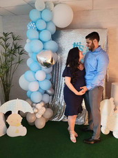 couple posing for photo at baby shower