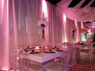 event venue decorated with pink fabrics and lights