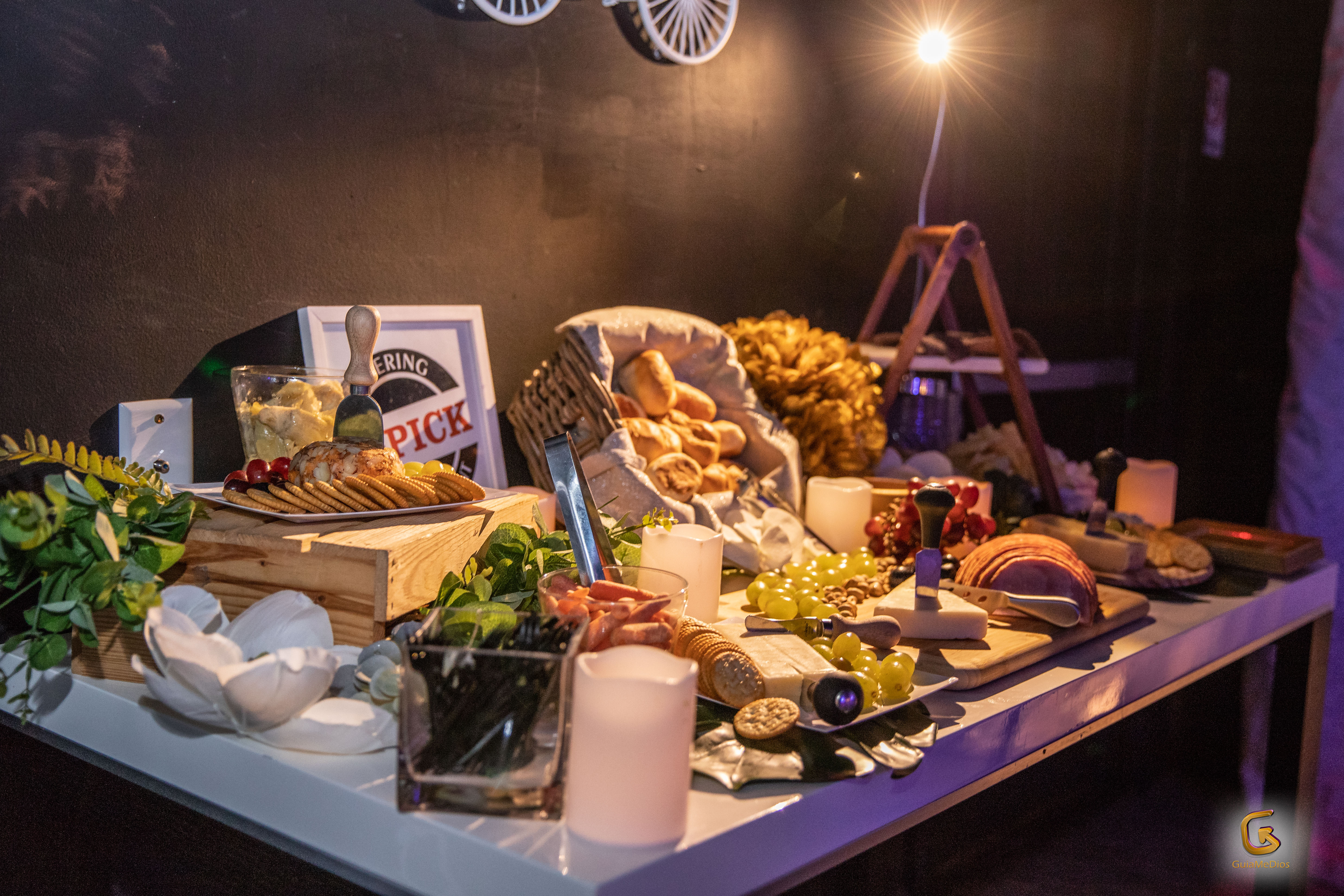 Grazing table with a lot of different food in a party venue