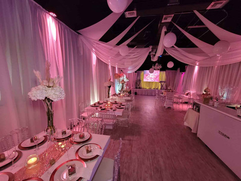 Banquet hall decorated with lights and fabrics
