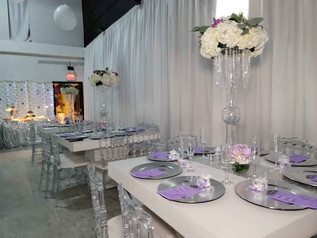 white and purple decorated tables at wedding