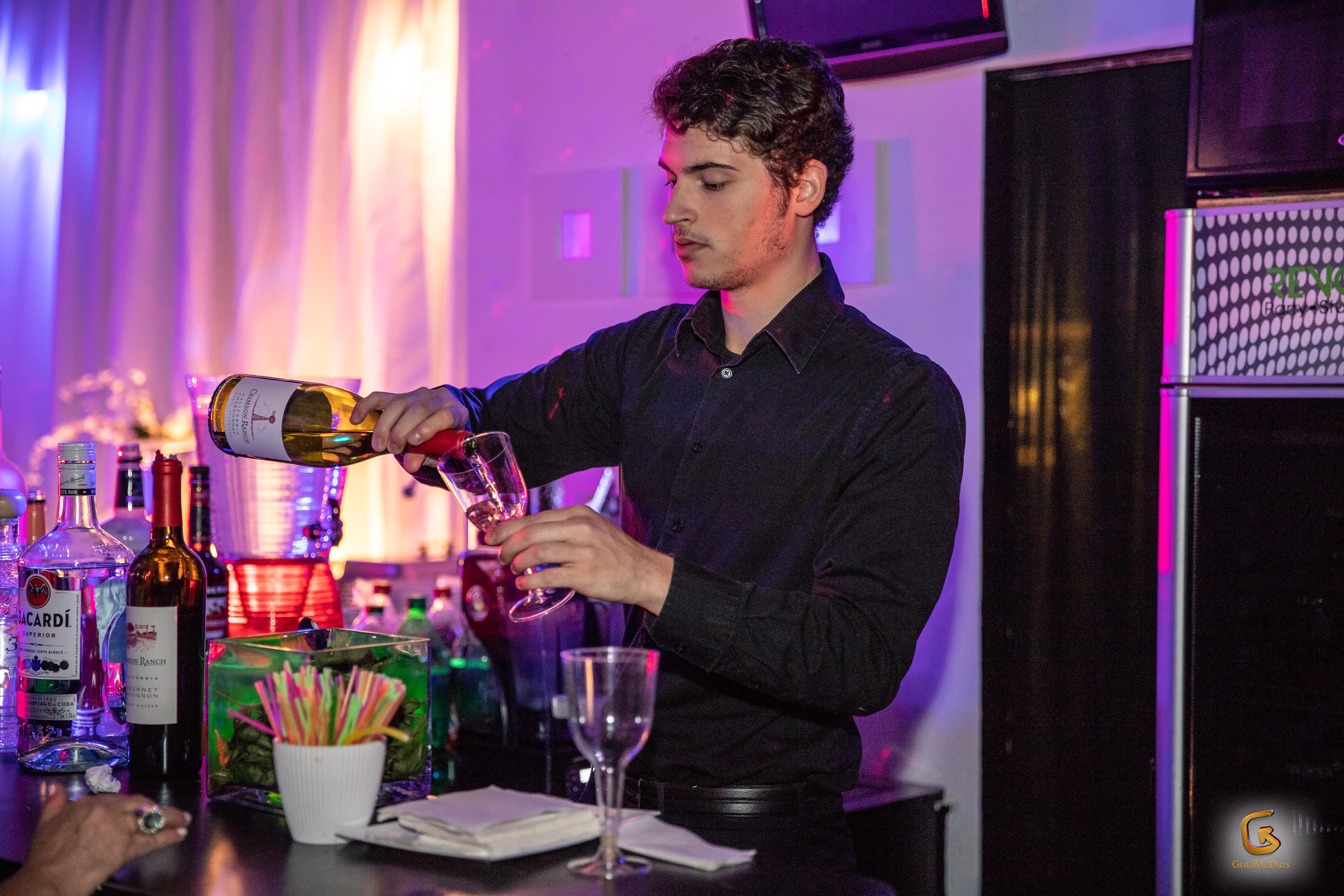 Bartender serving drink in a banquet hall in Kendall Miami
