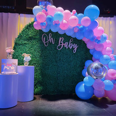pink and blue balloon arch at baby shower