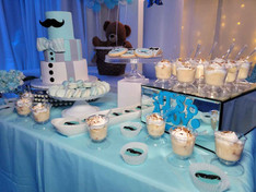 table with sweets blue decoration baby shower