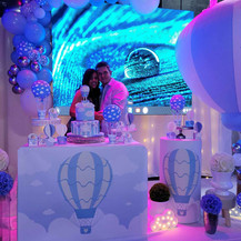 couple posing at baby shower in banquet hall