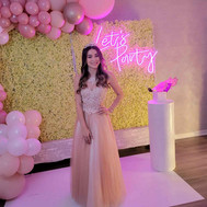 birthday girl in pink decorated event venue