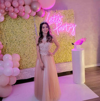 birthday girl in pink decorated event hall