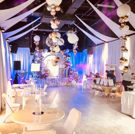 Ballroom with golden and white balloon arrangement