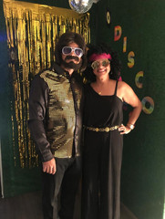 couple disguised from the 80s at a theme party venue
