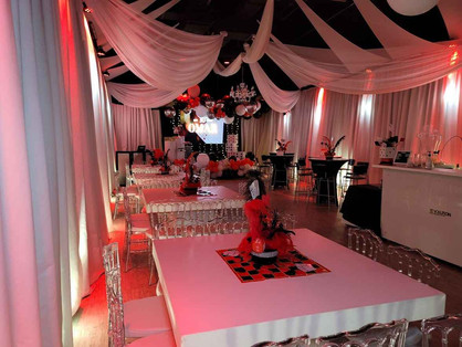 Elegant and beautiful event venue with red lights and white decoration