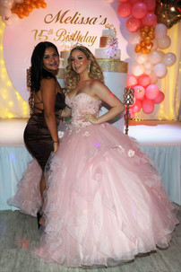 2 womans posing at the camera in a party venue decorated with balloons