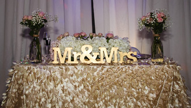 Table arrangement with initials of Mr Mrs wedding