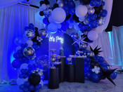 white and blue balloons in a party venue