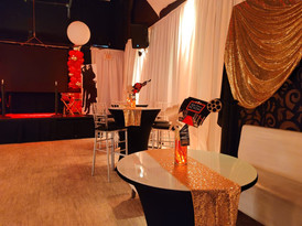 black, red and gold decoration in party venue in Kendall Miami with orange centerpieces