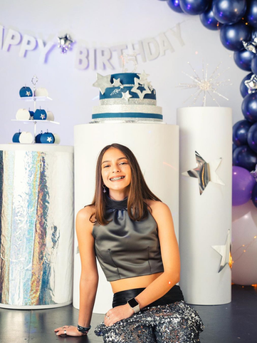 Cylinders with blue cake and party decoration in event venue