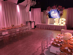 event venue with pink decorated stage