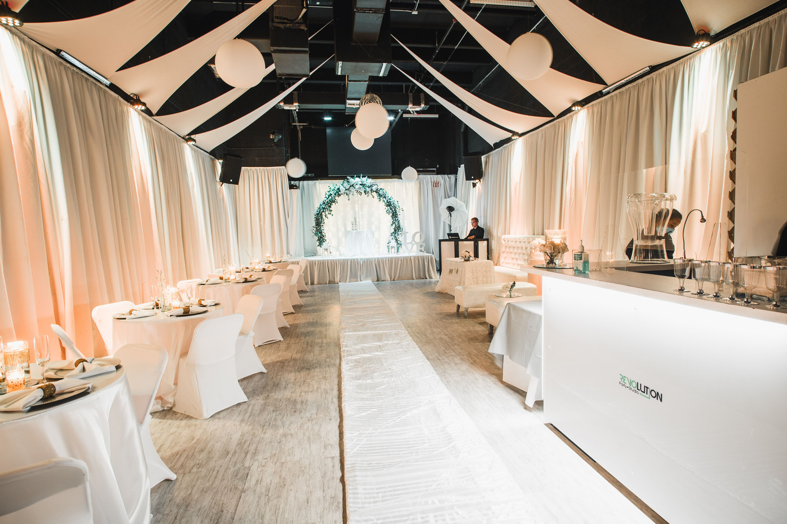 Wedding venue with a white carpet along the floor in Kendall Miami