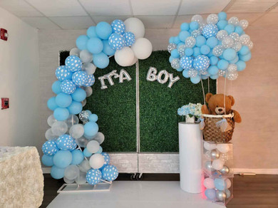 Baby shower with blue balloon arch