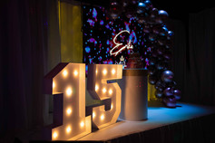 15 sign with lights in a stage