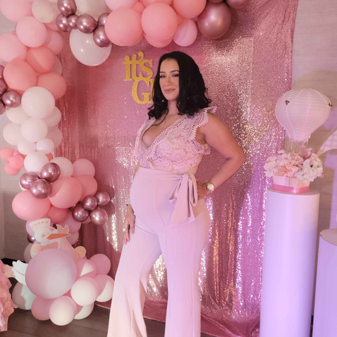pregnant girl in pink decorated baby shower