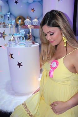 pregnant woman at baby shower in event venue