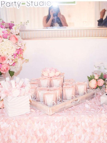 pink table with baby shower treats