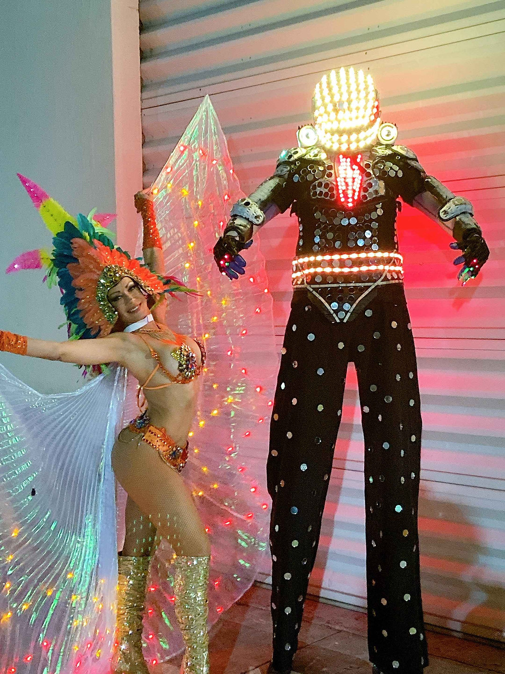 girl in carnival costume and led robot