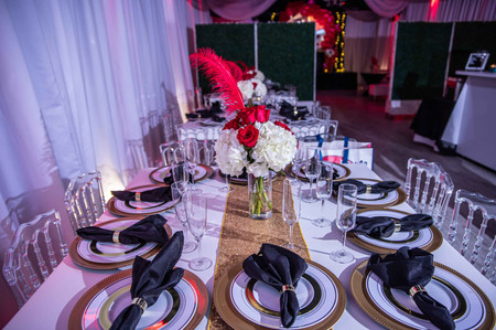 black and red decorated tables for party