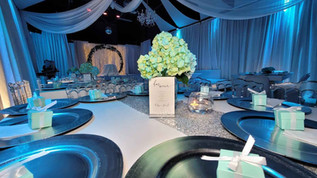 centerpiece with rose in blue banquet hall