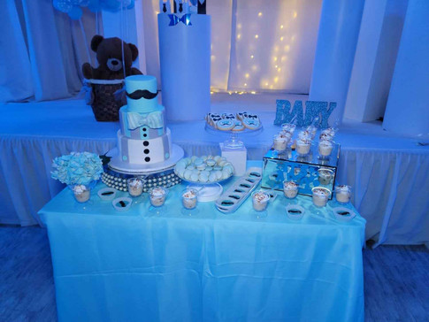 blue table with cake for baby shower