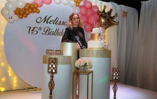 White, pink and golden decoration for 15 birthday party venue