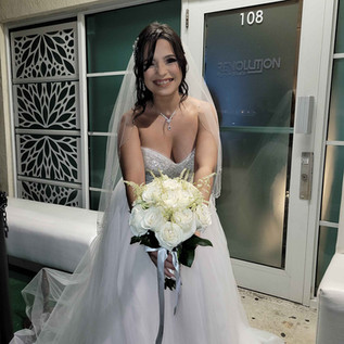bride with corsage entering banquet hall for wedding