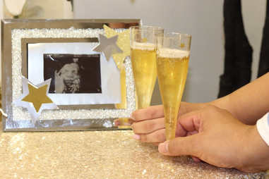 Couple toasting with photo of baby in a event venue in Kendall Miami