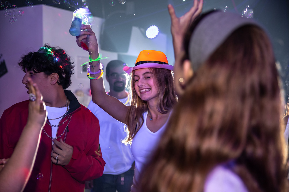 girl-celebrating-at-neon-party