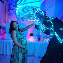 led robot giving show at baby shower