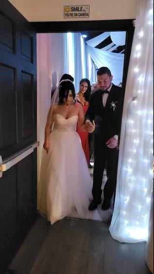 couple entering wedding hall in miami