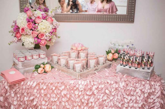 Pink table decorated with flowers on top