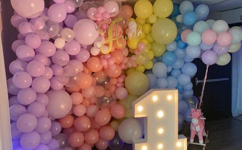 rainbow balloon arrangement for 1st birthday