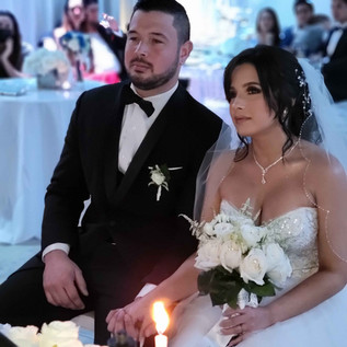 couple holding hands and getting married