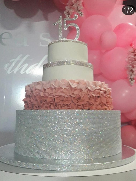 15th birthday cake decorated with white and grey
