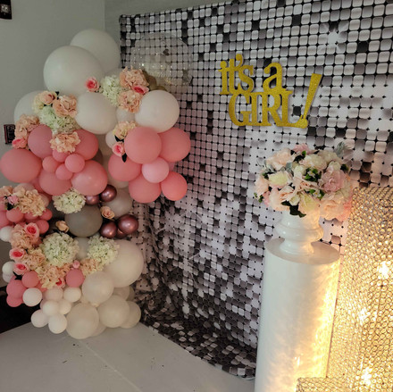 decoration with pink and white balloons baby shower