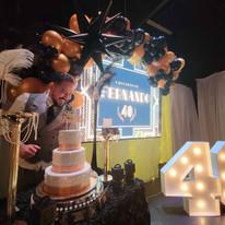 birthday boy next to cake on stage