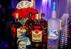 Various licor bottles in a party hall