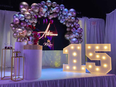 Stage with purple lights and 15 sign