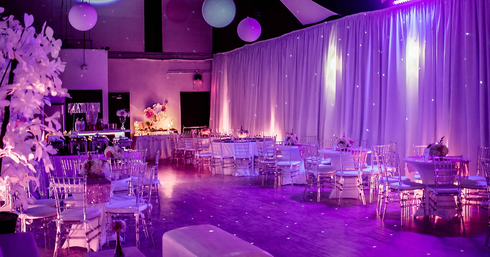 Banquet hall decorated pink for quinceanera party