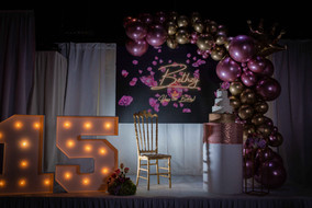Stage with decoration of metallic balloons for birthday