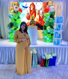 pregnant girl at lion king themed baby shower